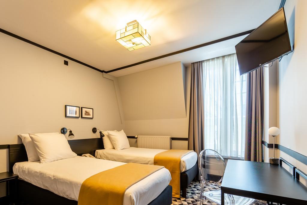 отель Брюссель Des Colonies комната